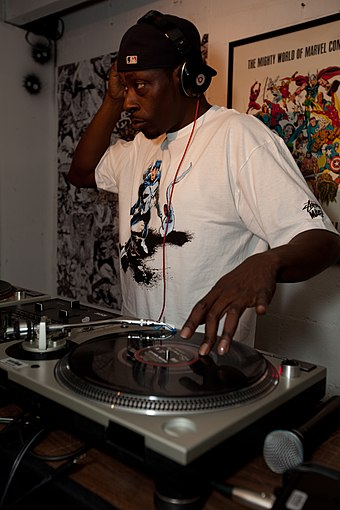 DJ Pete Rock mixing with two turntables. Pete Rock at Launch Party.jpg