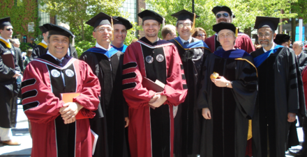 Professors and newly conferred doctors of philosophy posing at a Worcester Polytechnic Institute graduation. - Academic dress