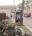 Phonebox amid fishing clutter, Main Street, Seahouses - geograph.org.uk - 1379463.jpg