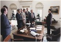 Photograph of President Reagan and his White House staff discussing the assassination of Egyptian President Anwar Sadat - NARA - 198521.tif