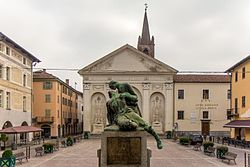 Piazza Sant'Agostino, old town. War memorial and Sant'Agostino church in the background