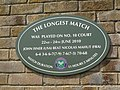 Plaque on Wimbledon Court No. 18 to commemorate the longest match in tennis history between John Isner and Nicolas Mahut on 22-24 June 2010.jpg