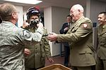 Polish Army Maj. Gen. Andrzej Falkowski, the Polish Defense Attaché to Washington D.C., tries on an F-16 pilot's helmet equipped with the joint helmet-mounted cueing system.jpg