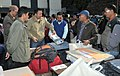 Polling officials checking Electronic Voting Machine (EVM) and other necessary belongings for use in the General Elections-2014, at the distribution centre, at Kurseong, Darjeeling constituency on April 16, 2014.jpg