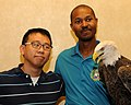 Posing for picture with Bald Eagle. (10594913776).jpg