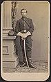 Private John E. Wildes of Co. B and Co. E, 15th Pennsylvania Cavalry Regiment in uniform with sword.jpg