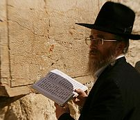 Man reading Psalms at the Western Wall.