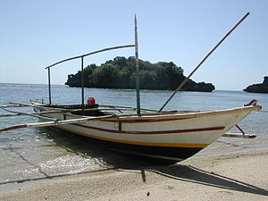 Pump boat - Pump boat that is used for fishing and to ferry passengers, on a beach on Taklong Island, Guimaras