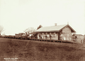 Queensland State Archives 2412 Goods train and people at Clifton Railway Station 1896.png