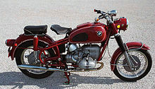 Red BMW R69US parked on a gravel/concrete surface