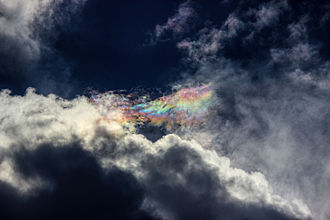 Cloud iridescence - Cloud iridescence, seen above the sun covered with grey clouds, Pondicherry, India