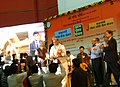 "Rajnath Singh lighting the lamp to launch the three social security schemes, ""Pradhan Mantri Jeevan Jyoti Bima Yojana"", ""Pradhan Mantri Suraksha Bima Yojana"", and ""Atal Pension Yojana"", at a function.jpg"