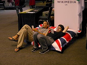 Relaxing on the beanbag at the WMUK stall in the Wikimania 2014 communities village.jpg