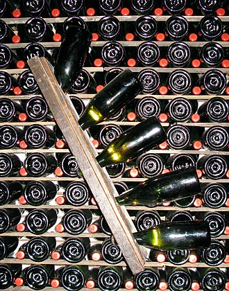 Trento DOC - Rémuage or Riddling: Gradual turning and inverting, which brings lees to bottle neck for removal.
