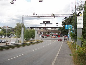 Congestion pricing - Trängselskatt automatic control point at Ropsten, Stockholm. The sign on the right informs the drivers about the different fees, that vary depending on the time of the day.