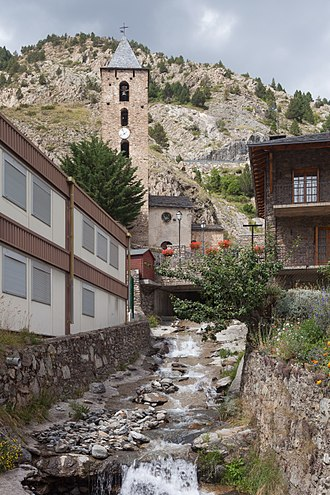 Canillo - Montaup River in Canillo with the church of Sant Serni at background.