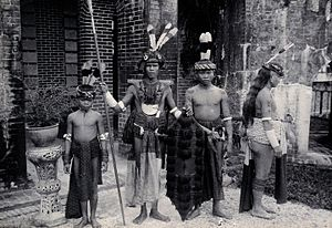 Iban people - Iban men complete with traditional attire, spears, Ilang and Klebit Bok.