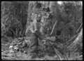 Sawing a kauri tree after it has been scarfed, near Piha. ATLIB 283185.png
