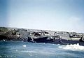 Scattered landing craft on beach of Iwo Jima 1945.jpg