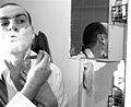 Self-Portrait shaving with reflection.jpg
