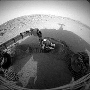 Mars Exploration Rover - NASA's Mars Exploration Rover Spirit casts a shadow over the trench that the rover is examining with tools on its robotic arm. Spirit took this image with its front hazard-avoidance camera on February 21, 2004, during the rover's 89th martian day, or sol 48.