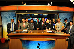 Pashto media - Shamshad TV studio in 2010. In the background are the station owner Fazle Karim Fazl, with former U.S. Ambassador Karl Eikenberry and Afghan Communications Minister Sangin Amirzai.