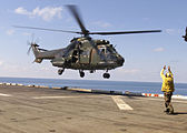 Singapore Super Puma lands on USS Inchon (MCS-12) 2001.jpeg