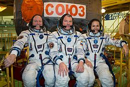 Soyuz TMA-14M crew in front of their spacecraft.jpg