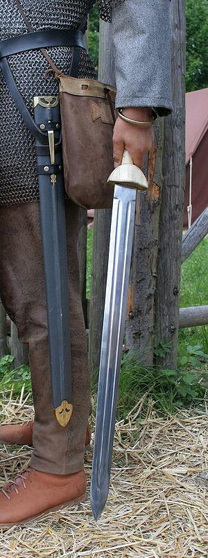 Spatha - Roman era reenactor holding a replica Late Roman Spatha