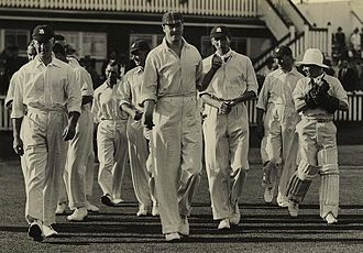 Harold Larwood - Chapman (centre) leads the England team on to the field during the Brisbane Test