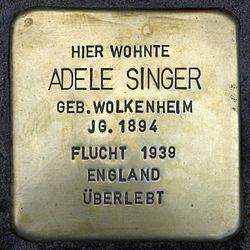 Photo of Adele Singer brass plaque