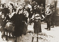 Warsaw Ghetto Uprising, April 1943: Warsaw Jews being held at gunpoint by SS troops (from a report written by Jurgen Stroop for Heinrich Himmler)