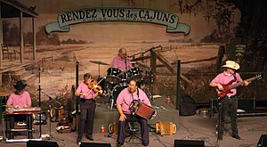 Lesa Cormier and the Sundown Playboys at the Liberty Theater in 2003.  All members are wearing pink.