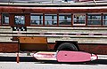 Surfboard and bus (8598634847).jpg
