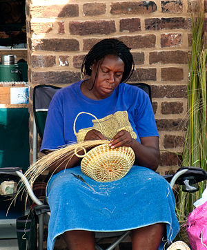 Gullah - A gullah woman makes a sweetgrass basket in Charleston's City Market