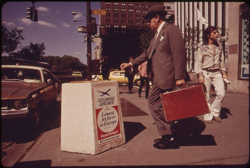 THE NEW CEMENT LITTER BASKETS ON FIFTH AVENUE ARE DESIGNED TO BE THEFT-PROOF AND TO PAY FOR THEMSELVES THROUGH THE... - NARA - 549812.jpg