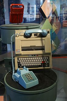 A photo of a Texas Silent Writer computer terminal with a blue telephone attached.