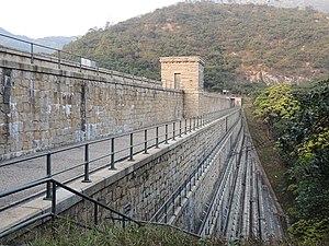 Tai Tam Waterworks Heritage Trail - Image: Tai Tam Upper Reservoir Dam 01