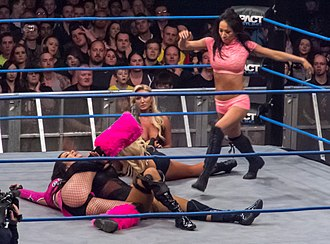 Pin (professional wrestling) - Tara pins Velvet Sky with a cover while Gail Kim attempts to break up the pin.