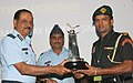 The Chief of Air Staff, Air Chief Marshal N.A.K. Browne presenting the Sports Trophy to Subedar Major Vijay Kumar, in New Delhi on October 19, 2012.jpg