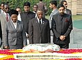 The President of Botswana, His Excellency Festus Mogae laying wreath at the Samadhi of Mahatma Gandhi at Rajghat in Delhi on December 08, 2006.jpg