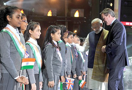 Since 1945, immigration to the United Kingdom under British nationality law has been significant, in particular from the former British Empire. The Prime Minister, Shri Narendra Modi and the Prime Minister of United Kingdom (UK), Mr. David Cameron interacting with the school children, at Wembley Stadium, in London on November 13, 2015.jpg