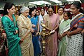"""The Speaker, Lok Sabha, Smt. Meira Kumar lighting the lamp at the inauguration of an Exhibition at the Seminar on """"Gender Justice and Responsive Governance"""", in New Delhi. The Union Minister for Culture.jpg"""