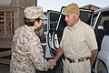 The chaplain of the Marine Corps U.S. Navy Rear Admiral Margaret Kibben, greets Terry Walker, training advisor to the commander of Regional Command (Southwest) (RC SW), at the RC (SW) compound aboard Camp 110924-M-LU710-010.jpg