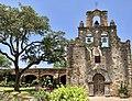 The very old Mission San Francisco de la Espada and a very young Texas Live Oak.jpg