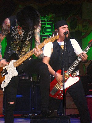 Metro Station (band) - Metro Station performing in 2009; Trace Cyrus (left) and Mason Musso (right)
