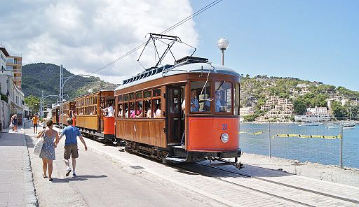 Tram 23 leading 4-car train in Port de Soller, next to the bay