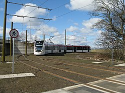 Tram from the airport - running empty (geograph 3377544).jpg