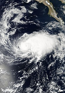 A visible satellite image of a tropical storm approaching hurricane intensity on August 31.