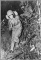 Two United States nurses carry heavy combat packs on a eight-mile hike through the jungle of the India-Burma border... - NARA - 535768.tif